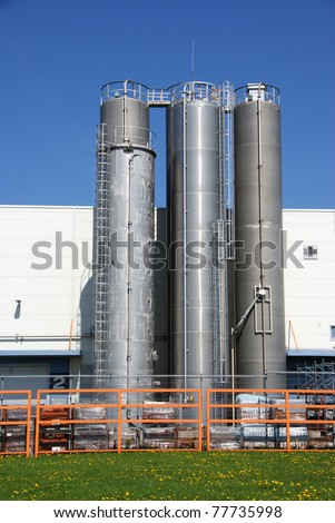 Three industrial bunkers are at a wall of industrial shop #77735998