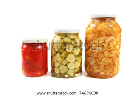 three jars of pickled vegetables - stock photo