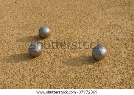 three Jeu de Boule balls