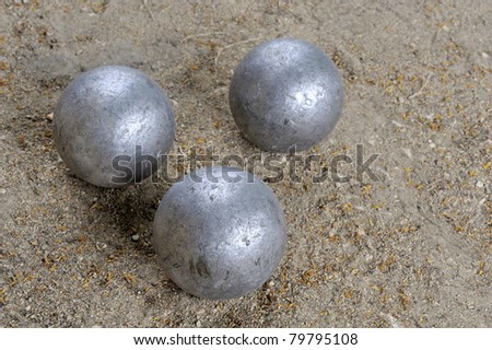 Three jeu de boules balls together at the ground