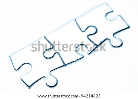 Three jigsaw puzzle pieces on plain background