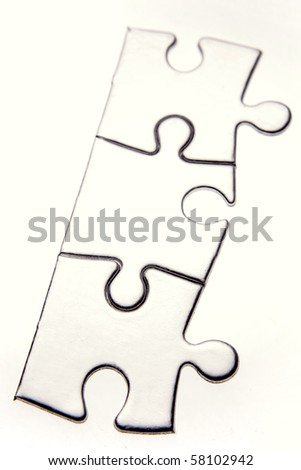Three jigsaw puzzle pieces on white