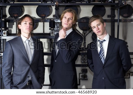 Three junior executives posing arrogantly, proud of their acquired and perceived status