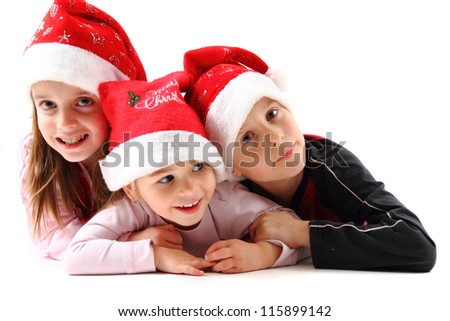 three kids and christmas isolated on the white background