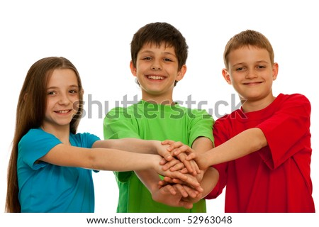 Three kids are holding their hands together ; isolated on the white background