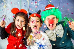 Three kids celebrating Carnival  together at home