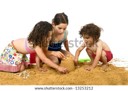three kids playing in the sand isolated on white