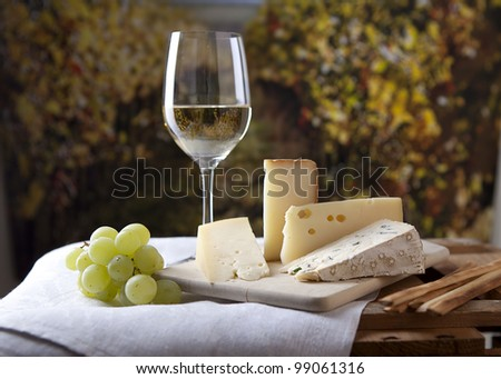 Three kinds of french cheese and a glass of white wine