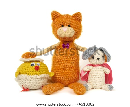Three knitted toys isolated on white. This image may depict friendship.