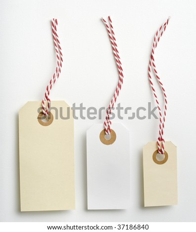 Three labels with red and white rope isolated on white - stock photo