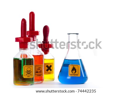 Three  laboratory dropper bottles and a conical flask with different coloured liquids and labelled with standard labels as toxic, corrosive, irritant and flammable.  On white.