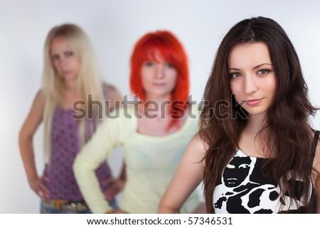 Three ladies posing on a white background