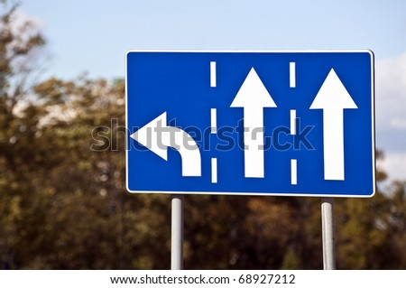 Three-lane traffic sign, left turn and straight arrows.
