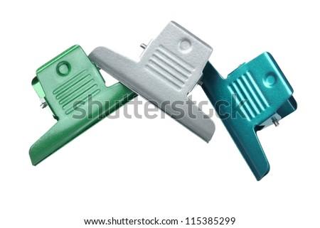 Three Large Binder clips on White Background