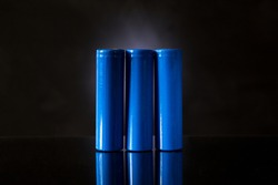 Three large high-ampere batteries on a black background.