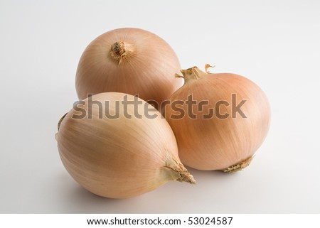 Three large onions isolated on white - stock photo