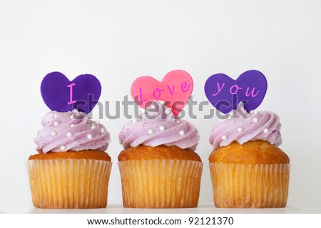 Three Lavender Frosted Cupcake with I Love You Written On Fondant