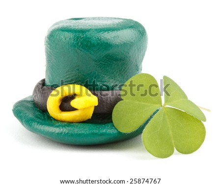 Three leaf clover and Green Leprechaun Hat on a white background. St. Patrick's Day symbol.