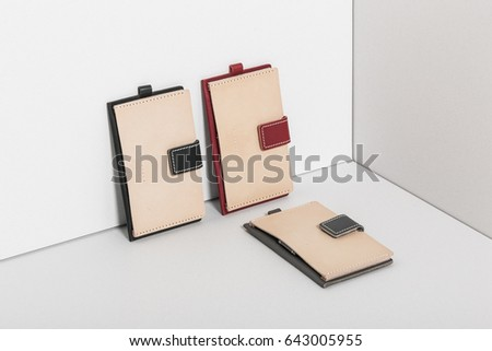 three leather case(pocket) for employee ID card, credit card on the grey background. #643005955