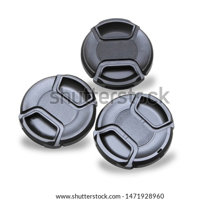 Three lens caps for digital camera isolated over white #1471928960