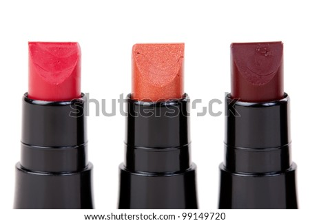Three lipstick set in a row, isolated on white background