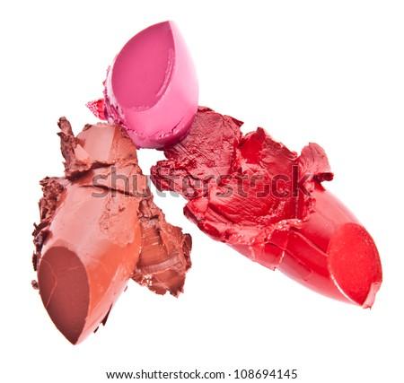 Three lipsticks isolated