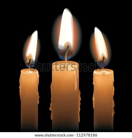 Three Lit Candles isolated on black.