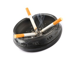 Three lit cigarettes in a black ashtray
