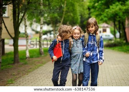 Three little friends go to school.