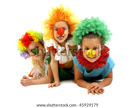 Three little girls as a clowns