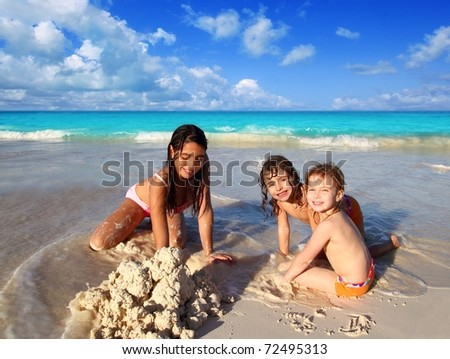 three little girls mixed ethnicity playing tropical beach Caribbean sea