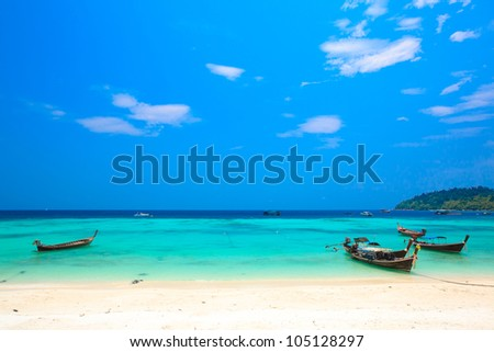 three long-tailed boat on Bundhaya beach Koh LIPE Thailand