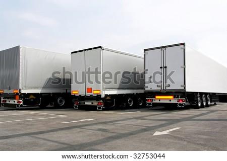 Three lorries of semi truck at parking