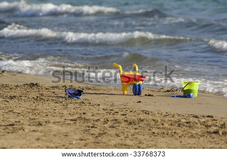 Three lost Toys on the Beach