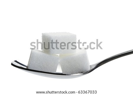 three lump sugar on a spoon isolated on white background