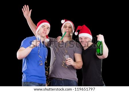 Three man wearing santa hat on a party