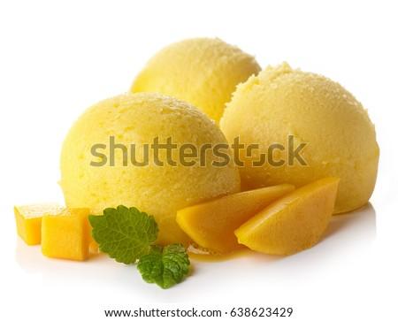 Three mango ice cream sorbet balls isolated on white background