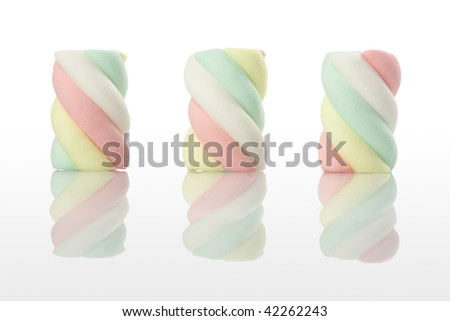 three marshmallows on white background