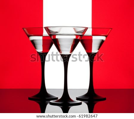 Three martini glass on a red-white-red background