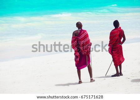 Three masai tribe member standing near the ocean in Zanzibar 4 February 2017