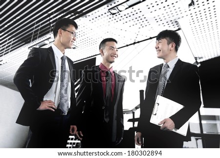 Three men are talking about