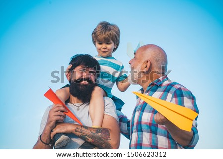 Three men generation. Generation concept. Airplane ready to fly. Three different generations ages: grandfather father and child son together