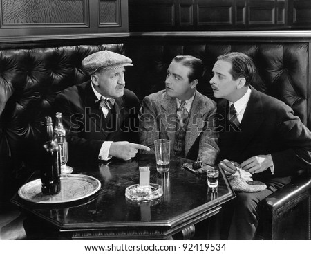 Three men sitting together at a bar