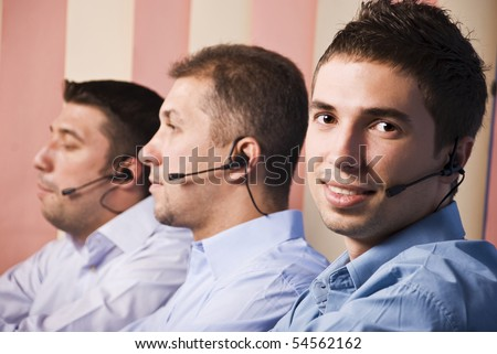 Three men support team working,focus on first man which smiling and looking you