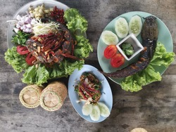 Three menus from catfish, Grilled catfish with hot chili sauce and vegetables, Spicy minced pork catfish and Fried catfish with mixed herb, Northeast food of Thailand.