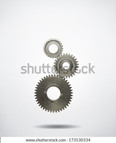 Three metal cog gears joining together