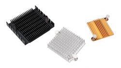 Three metal heatsinks of anodized aluminum isolated on white background. Closeup of coolers for remove waste heat of computer and electronic devices as integrated circuits, chipsets or graphics cards.