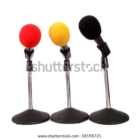 Three microphones isolated on white background