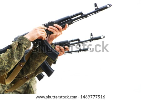 Three military machine gunners reload weapons and shoot on a light background. Threat of conflict. Daylight. #1469777516
