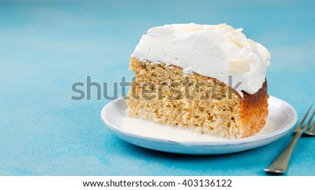 Shutterstock Three milk cake, tres leches cake with coconut. Traditional dessert of Latin America Copy space